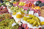 Exotic fruits on display on a market — Stockfoto