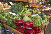 Fresh vegetables on display on a market — Stockfoto