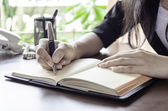A woman noting — Stock Photo