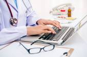 Doctor typing on computer — Stock Photo