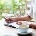 Woman writing a diary — Stock Photo #79013400