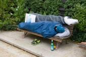 Homeless man sleeping — Stock Photo