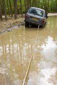 Four wheel drive on muddy track — Stock Photo