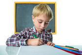 Schoolboy and blackboard — Stock Photo