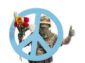 Soldier and peace symbols — Stock Photo