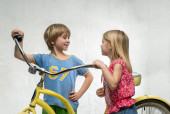 Children with bicycle — Stock Photo