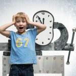 Boy with clock — Stock Photo #75495163