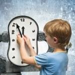 Boy with clock — Stock Photo #75495289