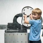 Boy with clock — Stock Photo #75495577