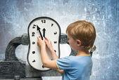 Boy with clock — Stock Photo