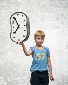 Boy with clock — Stock Photo