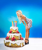 Sexy girl with cake — Stock Photo