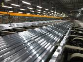 Aluminum lines on a conveyor belt in a factory. — Stock Photo