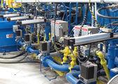 Heater machine aluminum rods — Stock Photo