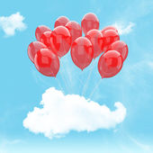 Escape conceptual- bunch of red balloon holding cloud into the sky background — Stock Photo