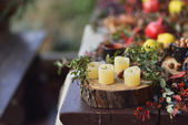 Candles and fruit — Stock Photo