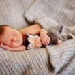 Newborn baby sleeping on fur bed — Stock Photo #67873239