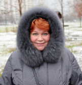 Smiling woman in winter — Photo