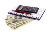 Business still-life with objects of business. Dollars and calculator — Stockfoto