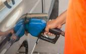 Hand refilling oil with car on gas station — Stock Photo