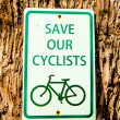 Bike public information sign  on tree background — Stock Photo #60497463