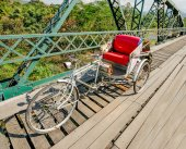 Tricycle bicycle on old  bridge in the north of thailand — Stock Photo
