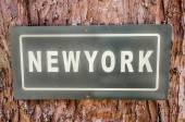 Sign of newyork text plate on tree background — Stock Photo