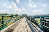 Old iron bridge in the north of thailand  — Photo