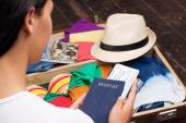 Young woman preparing things for a trip — Stock Photo