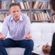 Man talking to his psychologist — Stock Photo #53520821