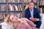 Depressed woman talking to her psychologist — Stock Photo