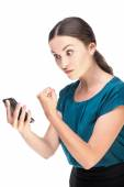 Frustrated and angry young business woman looking at smartphone — Stock Photo