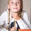Young school girl dreaming while lesson — Stock Photo #53920565