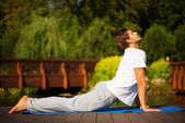 Yoga man in cobra pose — Stock Photo