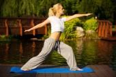 Young woman practising yoga — Stock Photo