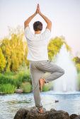 Yoga man doing tree pose — Stock Photo