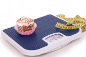 Pastry on weighs with measurer — Stock Photo