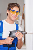 Smiling repairman with drill — Stock Photo