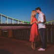 Couple standing near city river bridge — Stock Photo #57863401
