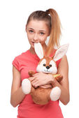 Teen girl with bunny toy — Stock Photo