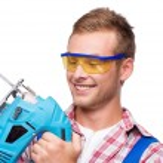 Smiling repairman with tool — Stock Photo #58580733
