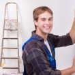 Repairman measuring with builder level — Stock Photo #58580823