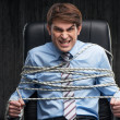 Angry knotted businessman under arrest — Stock Photo #59696159