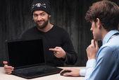 Computer hacker introducing laptop with virus — Stock fotografie