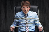 Angry knotted businessman under arrest — Stock Photo
