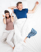 Top view photo of couple in bed — Stock Photo