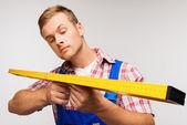 Repairman with builder level — Stock Photo