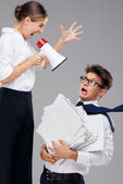Businesswoman screaming on fearful office assistant — Stock Photo
