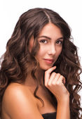 Portrait of good looking woman with curly hair — Стоковое фото