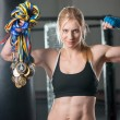 A beautiful young woman wearing a pair of boxing gloves — Stock Photo #65055567